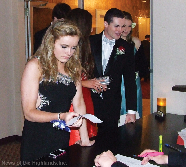 Tara Mannion checked into the prom at the Meadowbrook Lodge with Eva Lynch, Dylan Mannion and Taylor Lamities close behind.