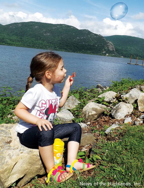 Photo by Suzanne Tagliaferro Summer is fun when you're young and carefree. On a weekday, when some of us were working, Olivia Olivieri visited the riverfront with her family, and blew bubbles.