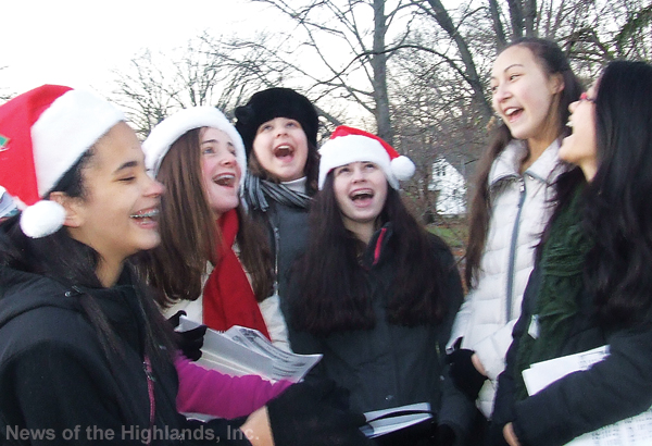 The Middle School Select Chorus sang carols at the Extravaganza during the day and at the tree lighting at night.
