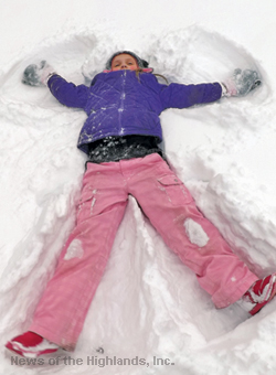 Photo by Suzanne Tagliaferro On Tuesday, Jan. 27, this young lady had no trouble making a snow angel in the front yard of her home on Willow Avenue.