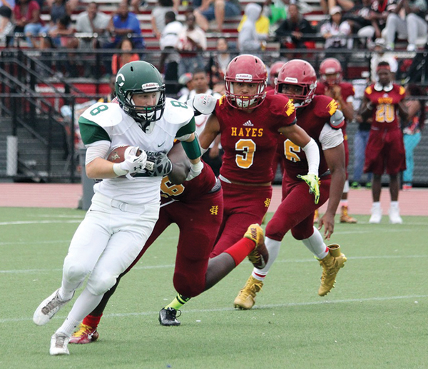 Photo contributed by Paul O'Flaherty Sophomore Ian Engenito turns the corner in the second half against Cardinal Hayes.