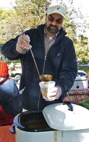 Jeff Knight pours chili into a cup at the Apple Time Fair.