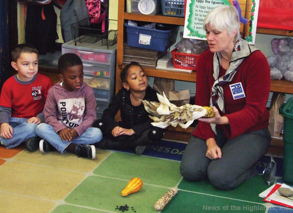 Photo by Jason Kaplan Dylan Corso, Greyson Bille, and Juliana Barry check out an ear of corn. Elise LaRocca, from the Hudson Highlands Land Trust, spoke to kindergarteners, in Shari Clerkin's class, about the Lenape tribe.