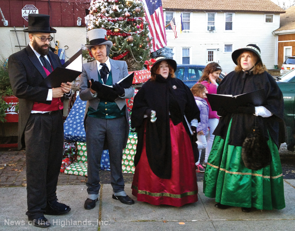 Photo by Jay LeRoy The Merry Minstrels sang Christmas carols as they strolled through town on Sunday afternoon.