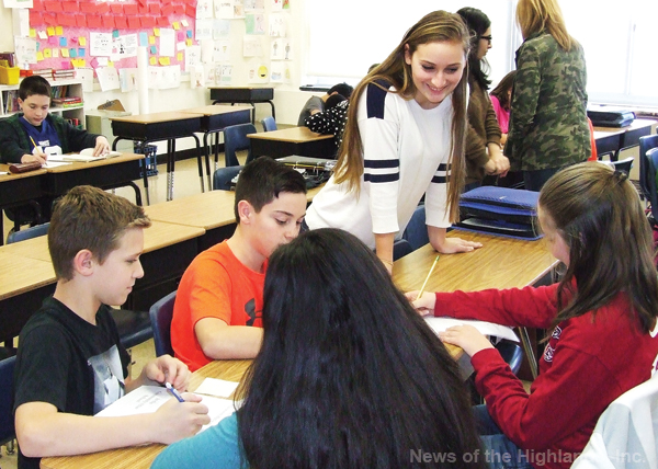 Kate Gleason, a Safe School Ambassador from Cornwall High School, helps students, in Jami Strasuss' middle school class, come up with ways to show respect.