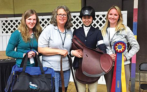 Contributed photo Lindsay Clark, lead trainer Susan Clark, Tomiko, and Jess Anselmo after Tomiko won a national championship.