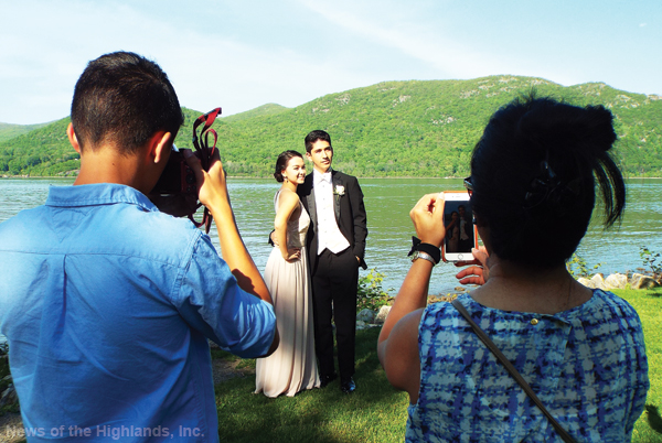 Photo by Jason Kaplan The Cornwall High School junior class held its prom on May 20. As has been an annual tradition, students stopped by Donahue Memorial Park for photos taken by family and friends. Colt and Emily Kirwan snap a shot of Michaela Kirwan and Charles Longueira.