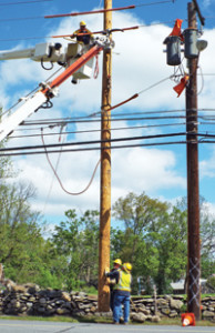 Photo by Ken Cashman A crew from Central Hudson began replacing utility poles on Main Street last week. Work is expected to continue between Oak Street and Tamara Lane, as well as the corner of Willow Avenue.