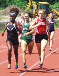 Photo by Ken Cashman Kayla Quarshie of Port Jervis, Gabby Fanning of Cornwall, and Sarah Rudge of Onteora lead the field with about 50 meters to go in the 800-meter run. The race was one of the first events of the state qualifying meet.