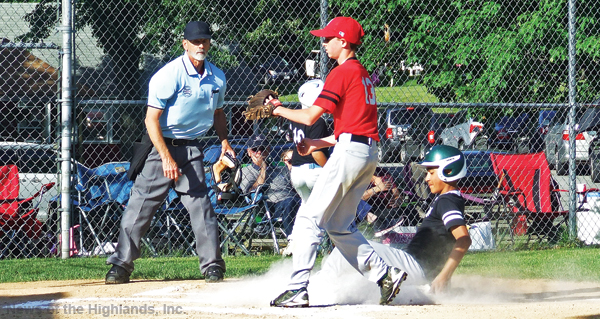 Photo by Ken Cashman Umpire Jim Schilling is about to give the safe sign as Marco Olavarria slides home ahead of the throw to Cardinal pitcher Patrick Murphy. The run gave the Mets a 3-0 lead on their way to a 7-1 victory.