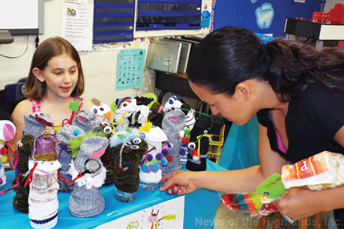 Photo by Jason Kaplan Aine Blum sold sock puppets at the third grade marketplace at Willow Avenue Elementary School.