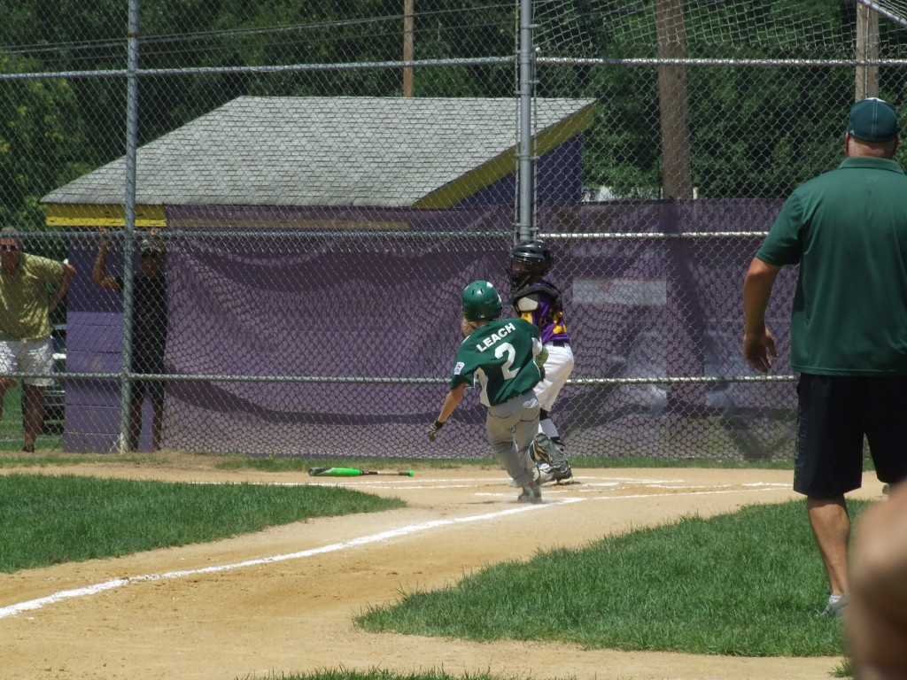Michael Leach scores Cornwall's second run in the championship game against Warwick.