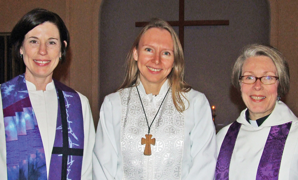Photo by Ken Cashman Pastor Julia Winward (center) shown at an ecumenical service with Rev. Tricia Calahan (left) and Rev. Suzanne Toro (right).
