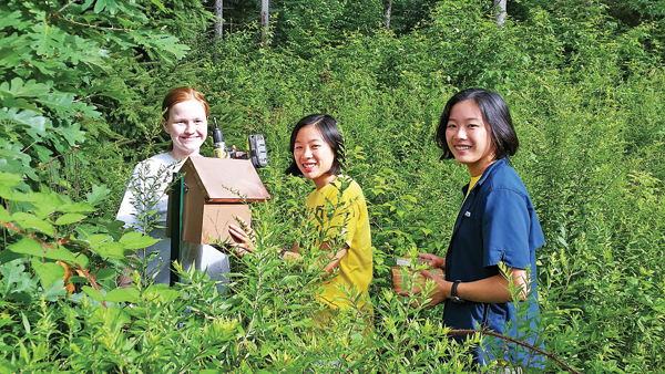 Contributed photo Catherine and Mary Tighe (center and right) helped Elizabeth Klosky mount her bee houses in Black Rock Forest.