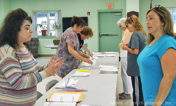 Lisa LaGrutta (right) showed up at Munger Cottage to see if she was eligible to vote in the Sept. 13 primary.
