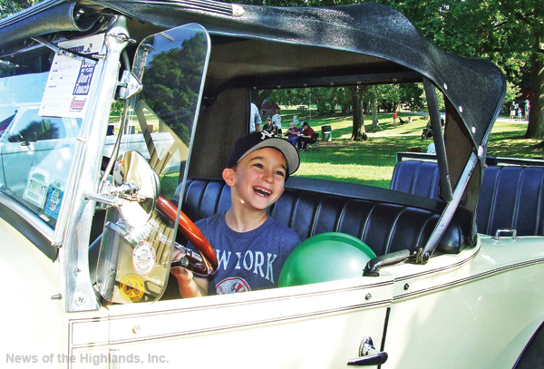 IN THE DRIVER'S SEAT: Ryan LaPolla got to turn the wheel and press the horn of a Model T Ford.