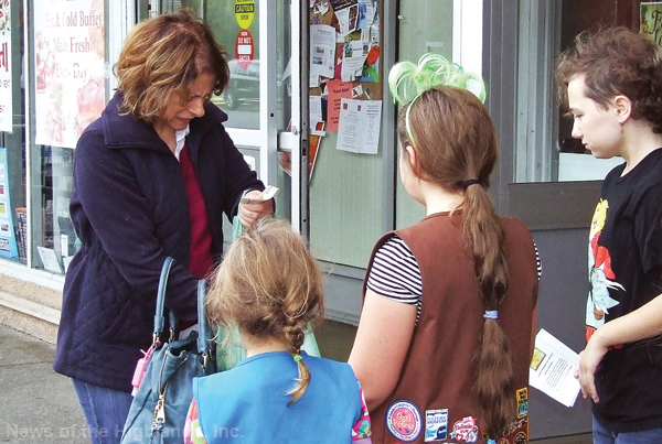 Photo by Jason Kaplan Girl Scouts collected food and monetary donations, in front of DeCicco's on Saturday, to benefit Backpacks for Food.