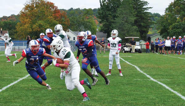 Dom Marzigliano (22) gains nine yards on Cornwall's opening drive in Goshen on Oct. 8.