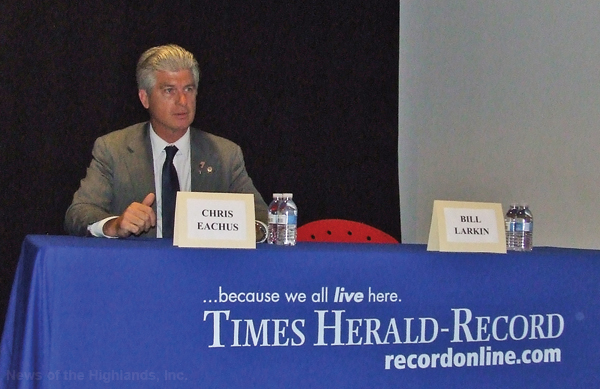 Photo by Ken Cashman County Legislator Chris Eachus is by himself at the candidates table on Oct. 17. His opponent, Sen. Bill Larkin, didn't attend the debate.