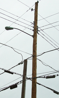 As Central Hudson moves lines to a new pole cuts the old, other companies have not been quick to move their utility lines.