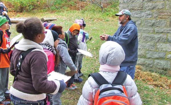 File photo John Brady, manager of Black Rock Forest, speaks to fourth-grade students on Oct. 28, the day they prepared for their archaeological dig.