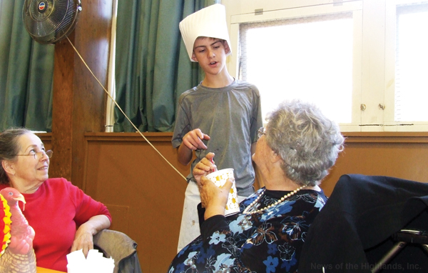 Nicholas Festa was one of several young servers at the Knights of Columbus Thanksgiving Dinner for senior citizens.