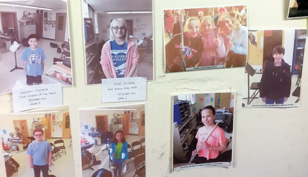 Photo contributed Each month Cornwall Middle School teacher, Steve Kessler, recognizes students in his class by placing their photos on his wall.