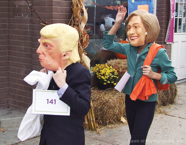 Photo by Jason Kaplan Presidential candidates Donald Trump and Hillary Clinton hit the campaign trail and stopped at the first annual Halloween parade. Over 100 children participated in the march up and down Main Street. Trump and Clinton, however, did not stick around as they had more potential voters to meet. The election is Tuesday.