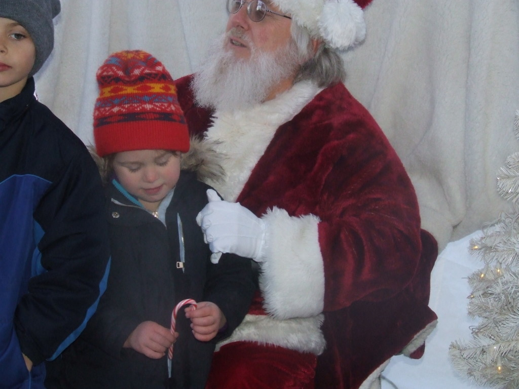 The youngest member of the Enslen family visits with Santa Claus on Bridge Street
