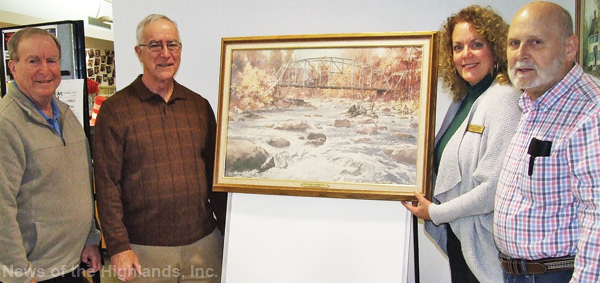 George Kane (right) gave the Cornwall Public Library a John Gould painting of the Forge Hill Bridge. With Mr. Kane (from left to right) are Paul and Bill Gould (sons of the artist) and library director Mary Lou Carolan.