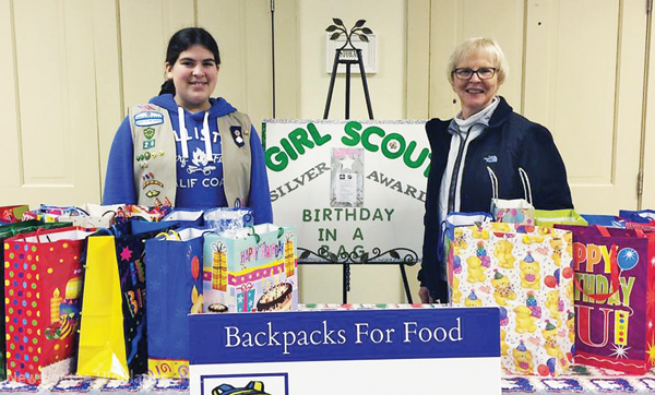 Photo contributed For her Silver Award project, Emily Cucci donated 25 birthday bags to Sally Mattausch, one of the organizers of Backpacks for Food.
