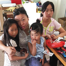 Contributed photo Ronghui, Mingxuan and Shiman Chen (far right) have been living like orphans in China. Their mother was killed in June in a car accident that left their father in a coma. Their aunt, Suki Chen (second from left) has been trying to bring them to America.