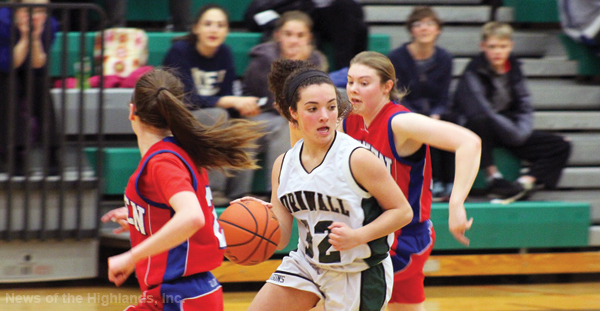 Photo contributed by Caitlin Dempsey Jessica Barbier (32) moves the ball downcourt in a Jan. 17 home game against Goshen.