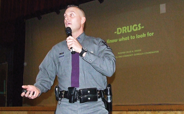Photo by Ken Cashman At the high school on Feb. 7, Trooper Craig Vedder told an audience of parents and school officials that there are clues to the drug world everywhere.