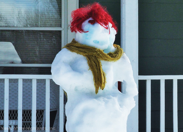 Photo by Jason Kaplan Not too long ago there was plenty of snow on the ground to build snowmen (and women). Many are the traditional figures with a carrot nose, but this one, sporting fiery red hair, could quite possibly be paying homage to the late actress and comedienne.