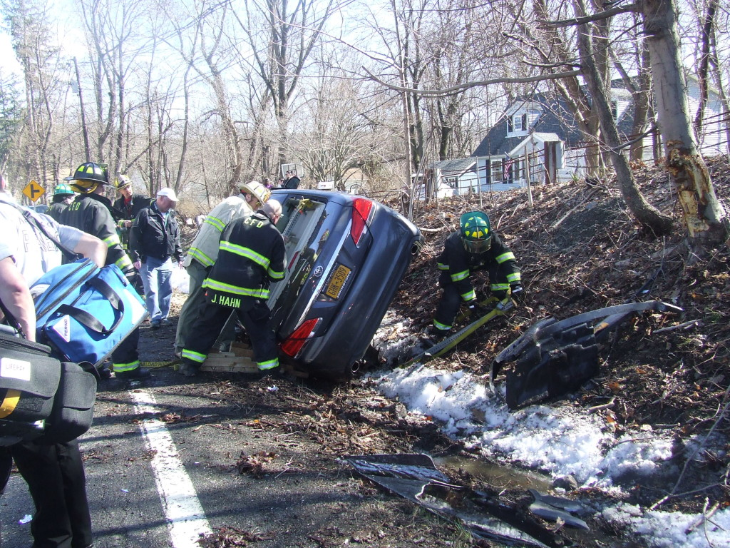 20 minutes after the crash, workers were still try to extricate the driver.