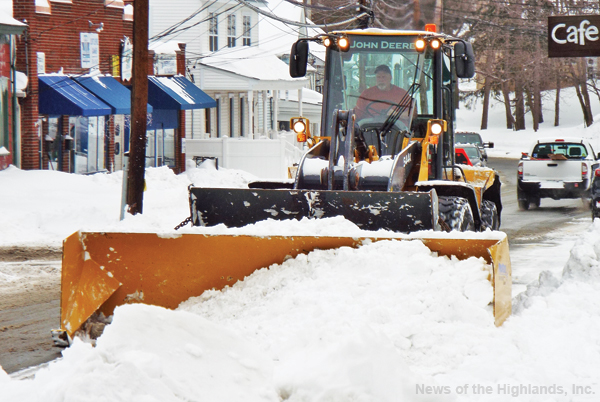 Photo by Jason Kaplan Clean-up from winter storm Stella continued Wednesday as Town of Cornwall Highway Department personnel cleared over a foot of snow from Main Street.