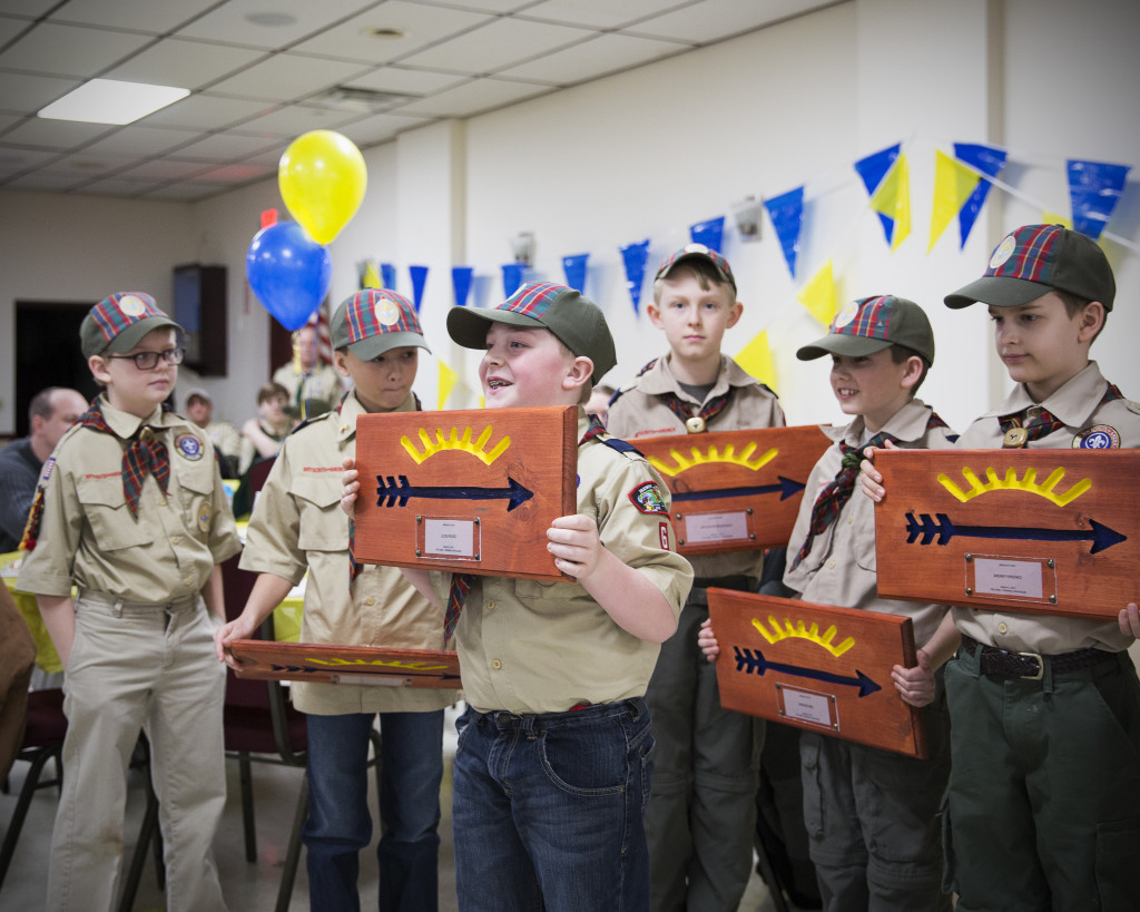 Photo contributed by Young Jang Deacon Toombs, Alex Restuccia, Lucas Russo (center front) Jefferson McDonald, Spencer Reel, and Andrey Kirienko of Pack 6 display their wooden plaques from Den Leaders, David Reel and Rob McDonald, before crossing over to Boy Scouts. The boys were at a Blue and Gold dinner at the Knights of Columbus Hall in Washingtonville.