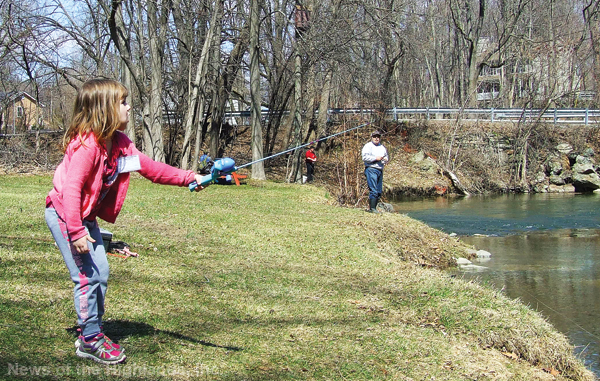 Photo by Jason Kaplan Hoping to catch a trout, Marissa Mugnano, 5, casts her line on opening weekend. Last year Mugnano caught a 19.5-inch trout during a fishing derby. The youngster has been fishing for three years.