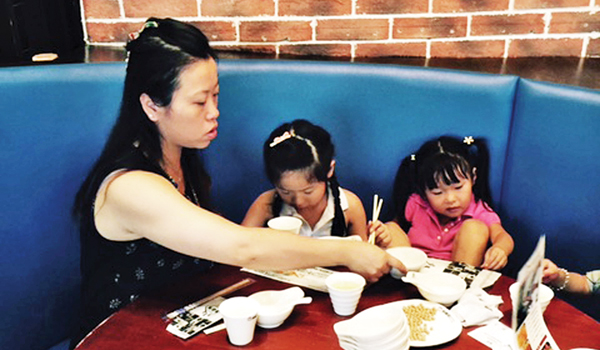 Contributed photo Suki Chen of the United States with her two younger nieces in a restaurant in China.