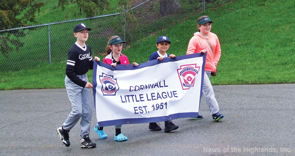 Photo by Ben Cashman Kevin O'Connor, Mia Dawson, Gabe Colsant and Emily Roohan carried the Cornwall Little League banner at the front of the Opening Day Parade.
