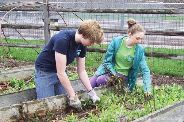 Charles Quinn and Nina Creta were among the two dozen volunteers who assisted in breaking down the garden at the high school. June 10 has been set as the target date for the completion of a new organic garden.
