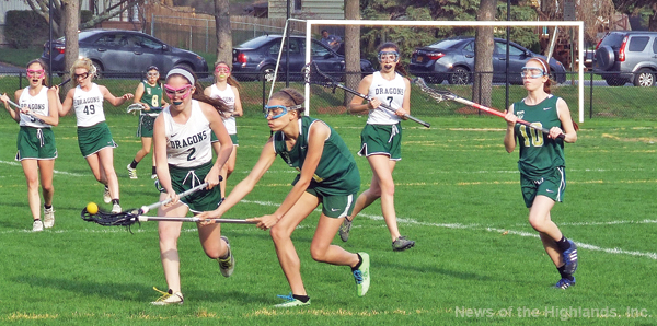 Samantha Fitzgerald (2) tries to steal the ball from an FDR player during the first half of an April 20 game. The Lady Dragons won 17-5.