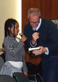Rep. Sean Patrick Maloney helps Angelica, a sixth-grader, formulate a question at a May 13 Town Hall Meeting at Cornwall Central Middle School.
