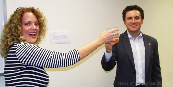 Mary Lou Carolan, director of the Cornwall Public Library, proposes a toast to Assemblyman James Skoufis who will be getting married this month. Mr. Skoufis was at the library on May 11.