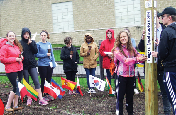 On April 25, Amanda Greenblatt's French Class dedicated a peace pole it received from the Rotary Club. The pole will be part of the high school's organic garden.