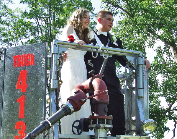 Photo by Jason Kaplan Storm King Engine Co. volunteers Andrew Cucci and Andrea Stambaugh took their pre-prom photos to new heights. The fire company's ladder truck was stationed at Donahue Memorial Park, on June 9, so the couple could pose for aerial photos in the bucket.