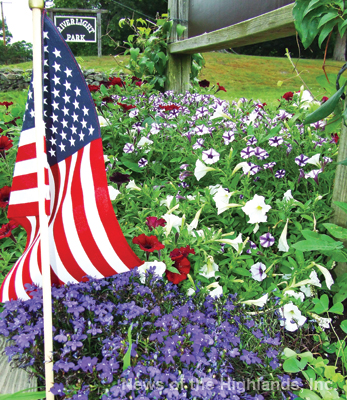 Photo by Jason Kaplan A red, while, and blue array of flowers welcomes visitors to Riverlight Park in Cornwall. The park will be bustling with activity, on Tuesday, as the country celebrates its independence. See page 7 for a list of events scheduled throughout the day.