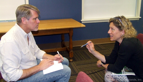 Don Weise signs a copy of his book for Susanne Vondrak at the Cornwall Public Library on June 27.