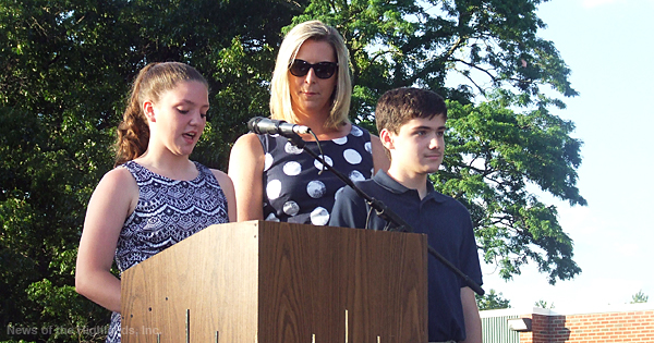 Surrounding Principal Kate Palumbo are essay writers Catherine Lawrence and Justin Vreeland. Both of them spoke at the June 21 Moving Up Exercises at the middle school.